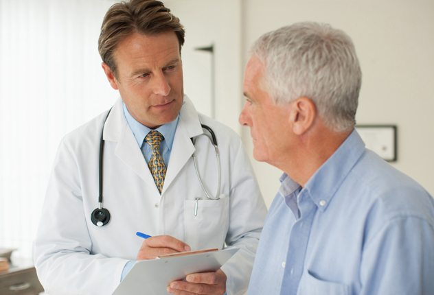 Doctor talking with patient in doctorÂ?s office